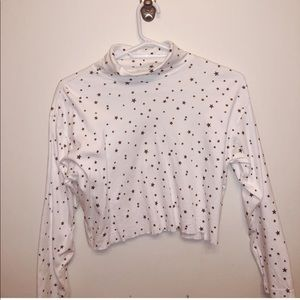 Cropped white turtle neck with star pattern